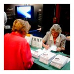 "AMHF author Joanne Gavin signs a copy of ""Live Your Dreams, Change the World"" for Dr. Ruth."