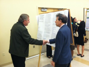 AMHF executive director Evander Lomke, with an interested party, at Poster Session IV. (Photo by Amanda Torres)